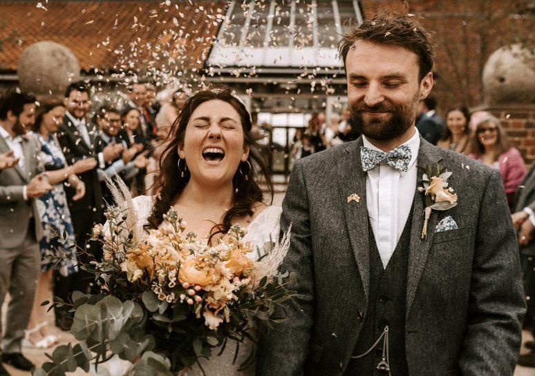 Godwick Hall wedding couple showered in confetti