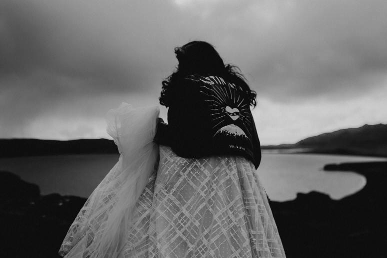 Bride wearing personalised black leather jacket in Iceland elopement