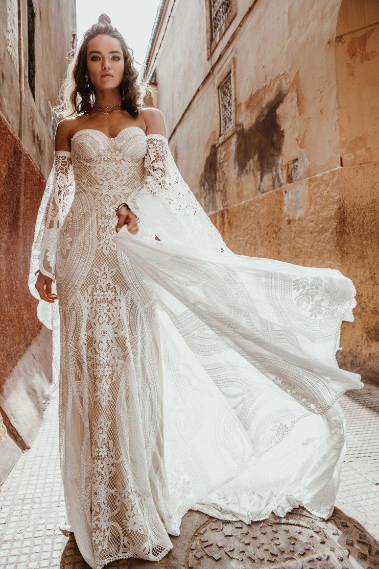 moroccan wedding bride wears sleeved lace rue de seine wedding dress