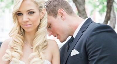 brighton wedding photographer groom kissing bride shoulder