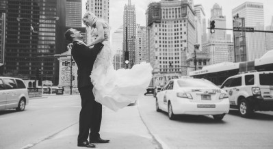 brighton wedding photographer groom picking up bride