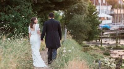 brighton-photographer-country-estate-wedding-walking-near-marshes-at-sunset