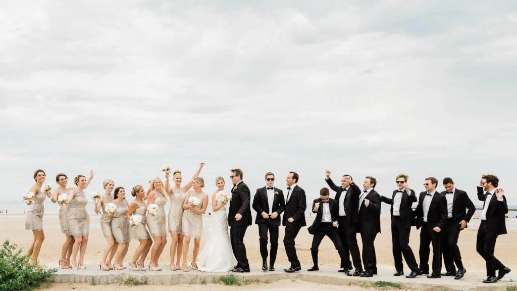 Large bridal party along seaside |  Brighton wedding photographer