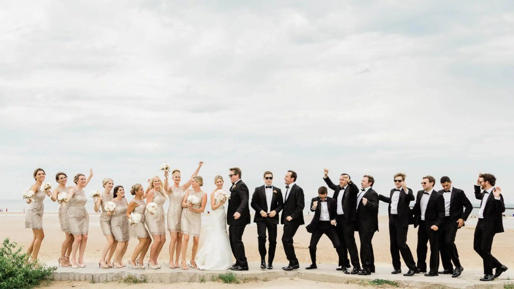 Large bridal party along seaside |  Brighton wedding photographer