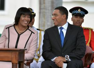 Portia Simpson-Miller and Andrew Holness share a smile at Holness' inauguration.