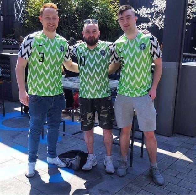 Photos of Oyinbo people rocking the Super Eagles jersey
