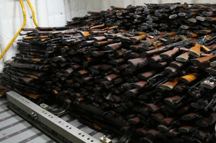 Piles of automatic weapons stacked up like cordwood