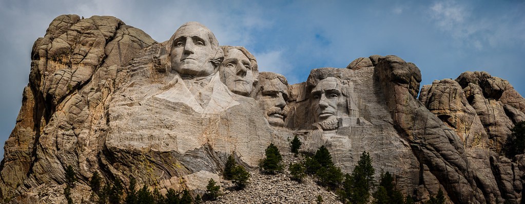 Panoramic view of Mount Rushmore, South Dakota, featuring the likenesses of George Washington, Thomas Jefferson, Theodore Roosevelt, and Abraham Lincoln