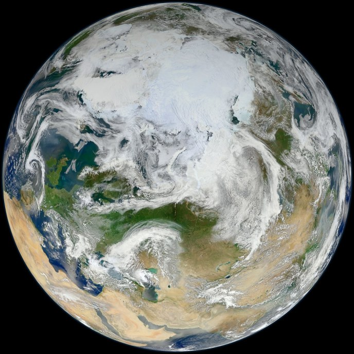 View of the earth from space, showing the Arctic, Europe and Asia