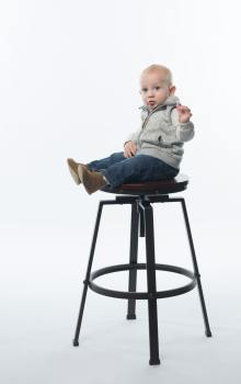 a child sitting on a high chair