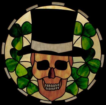 The Shamrocker stained glass panel featuring a Skull in top hat surrounded by shamrock leaves, designed by David Kennedy
