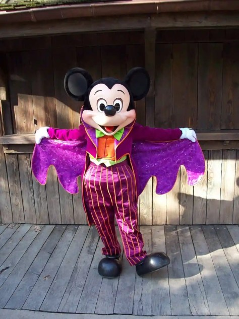 In 2008 Mickey was showing his Halloween side by wearing this purple Halloween outfit. Mickey couldn't decide if he wanted to wear his top hat with it or not, in this photo he decided to not wear it.