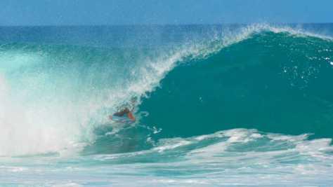 Banzai Pipeline surfer on the North Shore of Ohau Hawaii