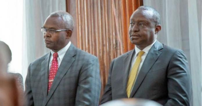 Former treasury CS and PS Henry Rotich (r) and Kimani Thuge (l) in court on July 23, 2019