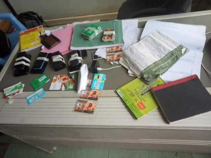 SIM cards and MPESA registration books found at the suspects