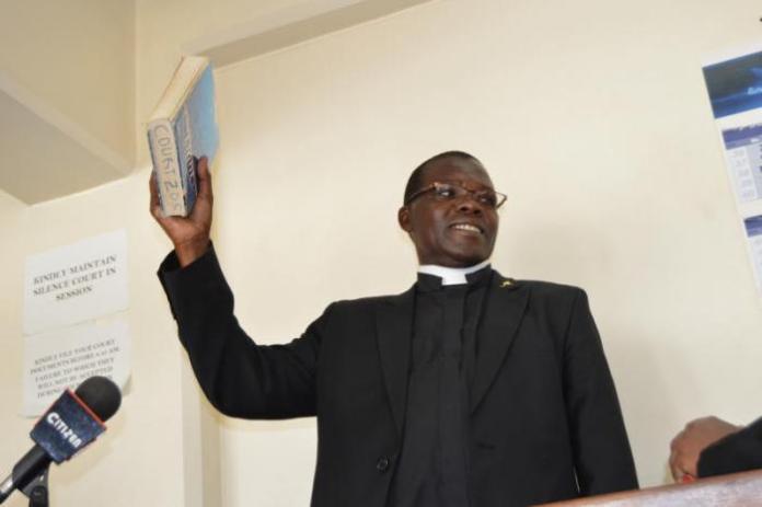 Catholic priest Jackson Micheni who testified on behalf of Linturi