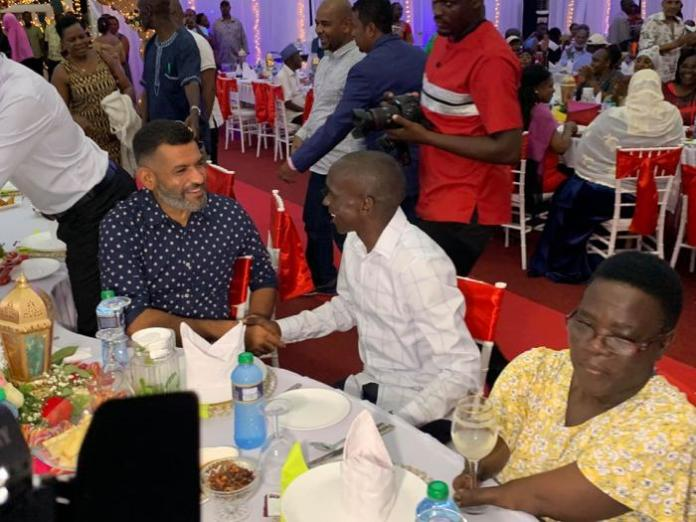 Eliud Kipchoge chats with Mvita MP Abdullswamad Shariff Nassir at the dinner which was held on Saturday, October 19.