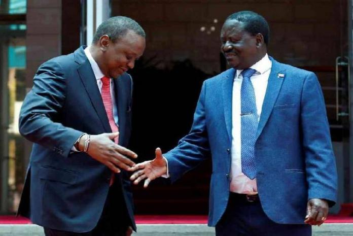 President Uhuru Kenyatta (L) and the ODM leader Raila Odinga on the footsteps of the Harambee House on Friday, March 9, during the much touted Handshake.