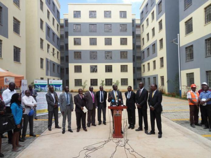 Government officials address the press at the hand-over ceremony for the Park Road, Ngara affordable housing project on Thursday, January 16