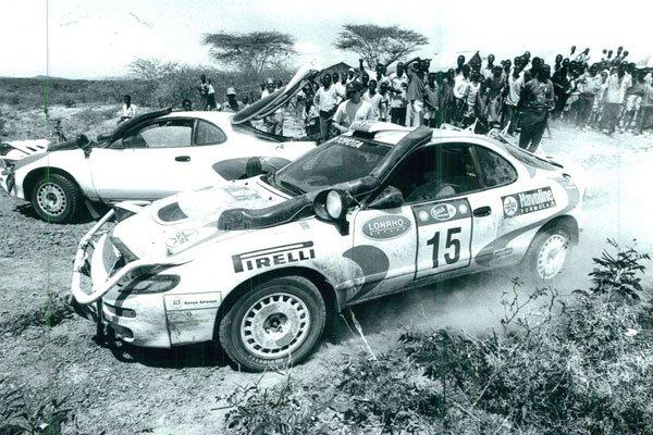A crowd watches as Jonathan Toroitich, navigated by Ibrahim Choge, tackle a section of the Safari Rally route in Naivasha in 1997