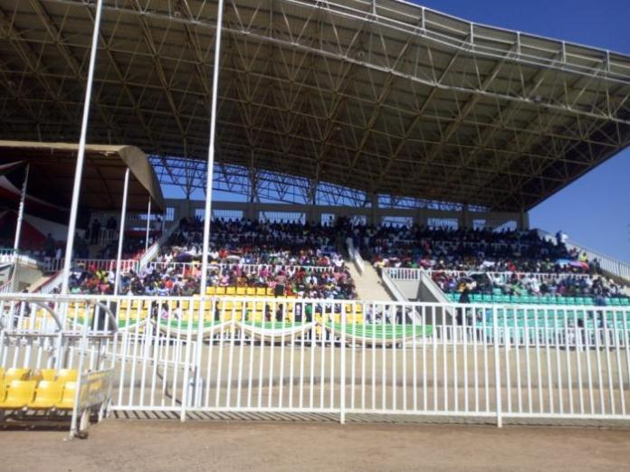 The crowd assembles at Bukhungu Stadium for memorial service of the 14 students who died in Kakamega Primary School