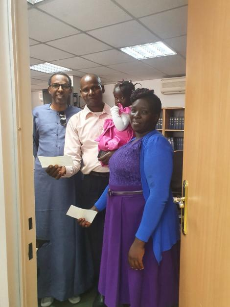 From Left: Constitutional lawyer Ahmednasir Abdullahi, a watchman Alfayo Omwenga, his wife and two children at the lawyer