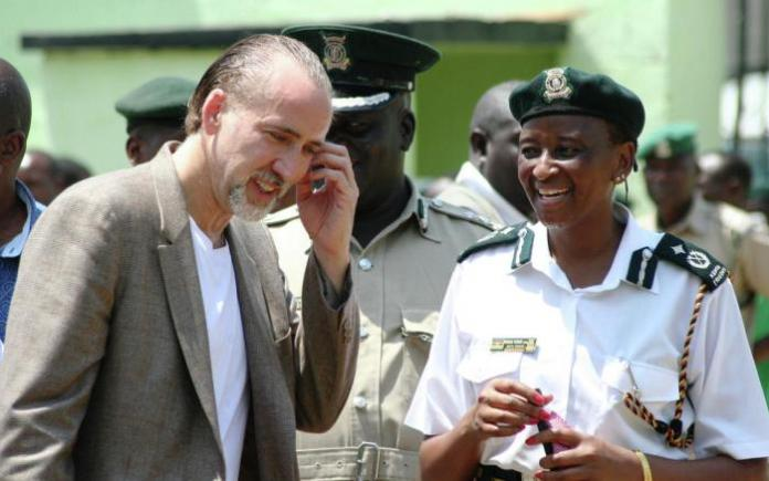 Hollywood movie star actor Nicholas Cage, left, who is also the United Nations Goodwill ambassador on Drugs and Crime laughs with Wanini Kireri.