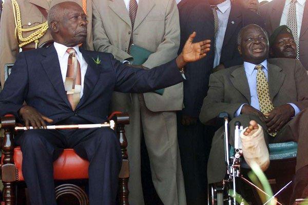 Former Presidents Daniel Moi (left) and Kibaki during the handing over of power at Uhuru Park in Nairobi, on December 31, 2002.