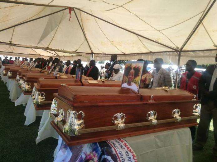 Coffins of the 14 pupils who perished at a stampede on February 3, 2020