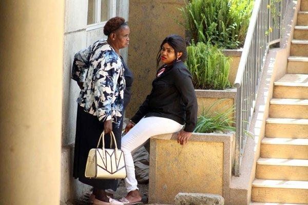 Ann Ngirita (right) and her mother Lucy Ngirita at the Milimani Law Courts on November 13, 2018.