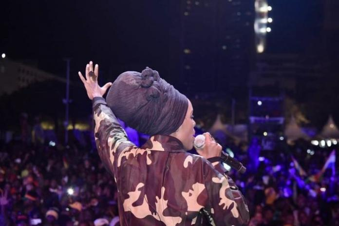Reggae femcee Njambi Koikai works up the crowd at KICC during a reggae concert held on February 15.
