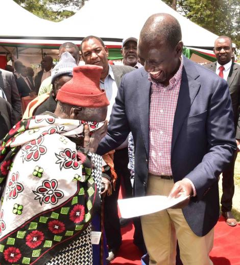 Deputy President William Ruto issues title deeds to a resident of Mosop, Nandi County on March 13, 2020.