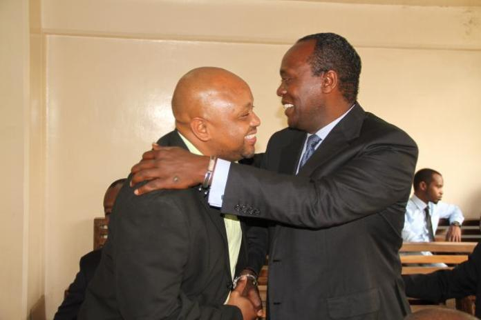 Jeff Koinange,(right) hugs political analyst Tony Gachoka when the two met at Milimani on June 5, 2015.