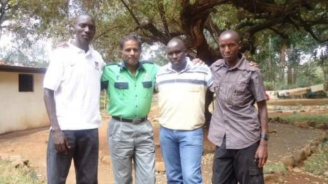 Embattled athlete Asbel Kiprop (far left) poses with Abdul Sidi (in green shirt)