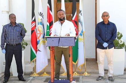 Mombasa Governor Ali Hassan Joho (centre) addresses the media in Mombasa on March 26, 2020