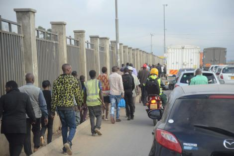 Nairobi residents walking to work due to increased cost of transport within the city.