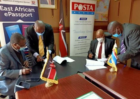 Post Master General Dan Kagwe and Director General Immigration Department Alexander Muteshi signing an MOU on July 30, 2020.