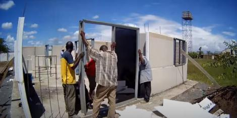 Workers assembling a prefabricated house