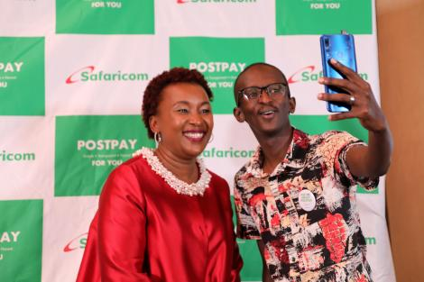 Safaricom Chief customer officer Sylvia Mulinge and Comedian Njugush Take a selfie during the launch