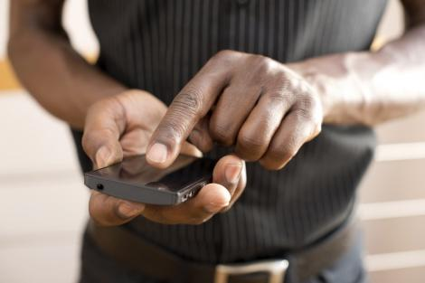 File image of a man using a phone