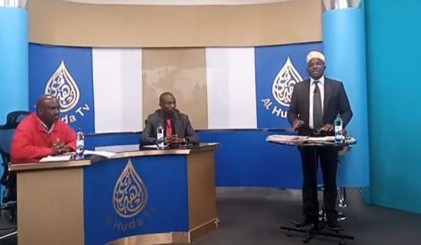 Dr Omari (standing) during an episode of his show on Al Huda TV.