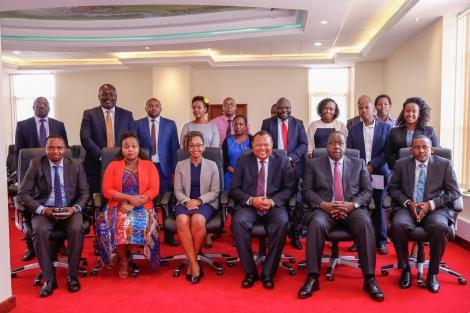 PDU Secretary Andrew Wakihiu and Interior CS Fred Matiang'i with other PDU staff at their new offices at Tourism Fund Building on September 23, 2020
