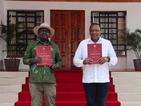 President Uhuru Kenyatta and former Prime Minister Raila Odinga display copies of the report after its presentation by the Building Bridges Initiative at Kisii State Lodge. October 21, 2020.