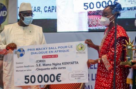 CS Monica Juma receiving the Macky Sall Peace award on behalf of Mama Ngina Kenyatta on December 11, 2020.