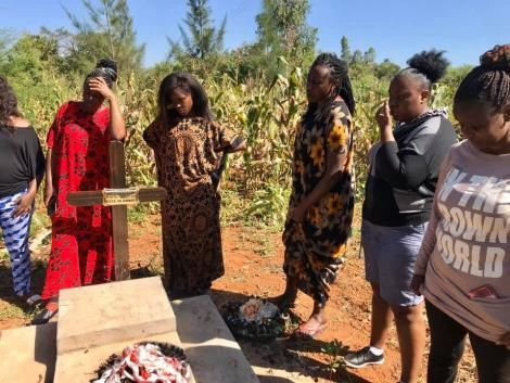 The cast along with the family of the late Papa Shirandula surrounding his graveyard.