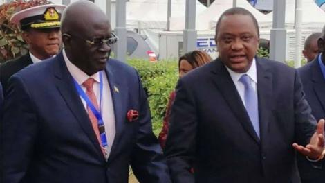 President Uhuru Kenyatta (right) speaks to Education CS George Magoha.