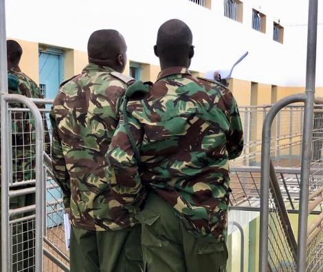 Kenya Police Officers inspecting a prison facility.