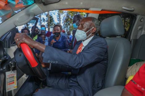 Former Likuyani Headteacher Mr. Naftali Olasya trying out his new car at his home in Likuyani on Friday February 26