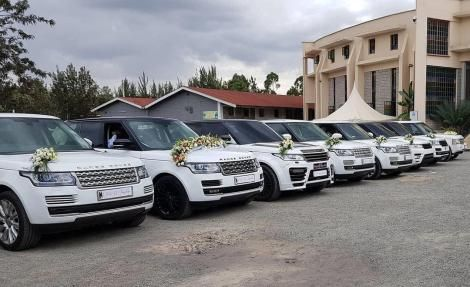 A convoy of white Range Rovers used for a past wedding