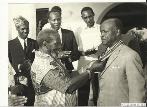 President Jomo Kenyatta awarding Justice Cecil Henry Ethelwood Miller a presidential award.